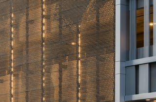 Detail of the perforated and corrugated metal surface at 1401 Lawrence.