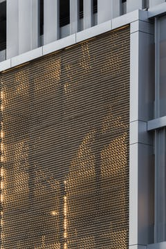 Detail of the perforated and corrugated metal surface.