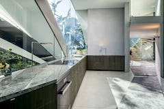 Interior stainless steel fascia divides the kitchen fenestration.
