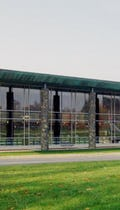 Prepatinated copper canopy caps the colonnade for Brandywine Hundred Library