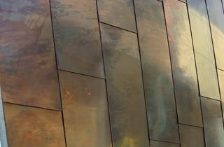 Detail of the custom patina on copper panels for the Waipolu Gallery.