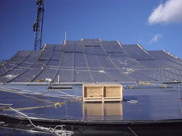 Field operators install the ZEPPS™ Panels on the South roof of Kauffman Center.