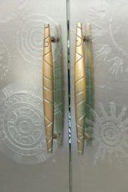 Custom bronze door handle for entry.