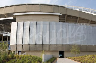 "Kauffman Stadium facade with perforated ""Royals"" logo emblazoned on its wall."