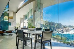 Glass and stainless steel meet to provide a bold interior space.