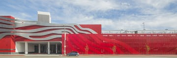 """The Petersen Automotive Museum uses ImageWall to continue the """"jet-stream"""" motif across its parking garage facade."""