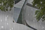 "A large glass ""gash"" cuts through the facade."