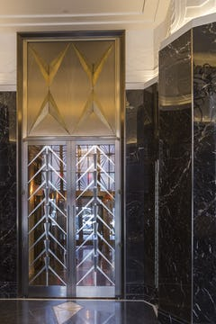 Custom transom medallions and doors for Walker Tower.