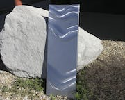 Wave-patterned stainless steel panel.
