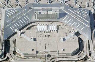 Aerial photo of the DFW Airport Terminal D with Inverted Seam roof system.