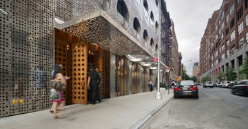 Hotel guests enter the south entrance of the Dream Hotel in NYC.