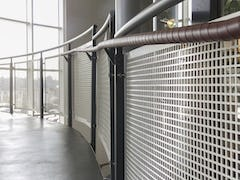 Handrail screens with custom perforations in aluminum
