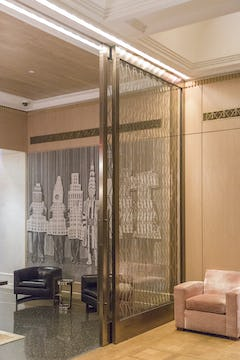 Interior sliding bronze doors.