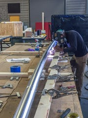 Fabricators at Zahner manufacture the signage and donor recognition for the SDCL Violin Bow.