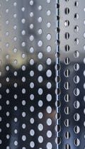 Detail of the interior screen wall with cross-seam perforation.