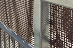 The contractor attached Zahner perforated panels to a galvanized steel structure.