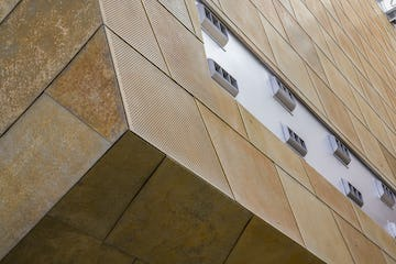 Custom perforated trapezoidal panel system for the Taubman Museum of Art.