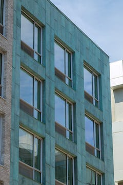 Facade for 174 North Eleventh with antique copper patina in Brooklyn, New York.