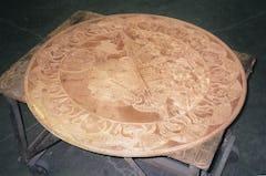 Medallion sculpture made using brass alloy