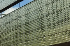 Image-perforated metal with color-shift iridescent painted aluminum.