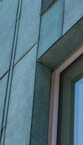 Detail of the custom facade for 174 North Eleventh with antique copper patina in Brooklyn, New York.