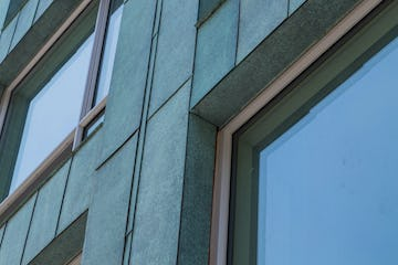 Detail of the custom facade for 178 North Eleventh with antique copper patina in Brooklyn, New York.