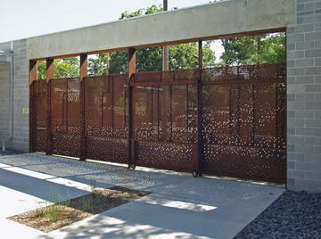 Light enters the space through the custom perforated metal for the Irving Courtyard Screenwall.