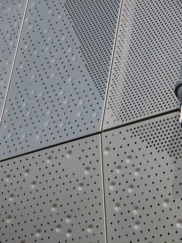 Detail of the perforated and embossed facade.