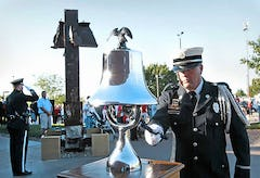 OverlandPark Firefighter Craig Robinson rang a bell for each of four important moments in the disaster.