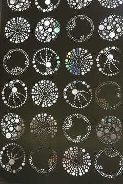 Detail of the custom perforated iconography at the Exploratorium.