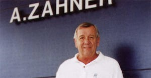 Leo Zahner Jr., in front of the A. Zahner Company sign at its front entrance.