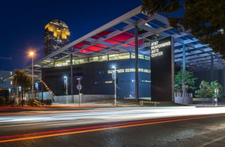 Photograph of the Winspear Opera House at night in Dallas, Texas