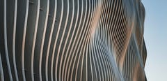 Fin-based facade design for parking structures using CloudWall by Zahner.