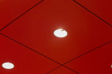 Detail of the recessed lighting system detailed in the aluminum canopy's interior ceiling panels.