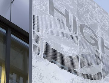 Detail of the perforated metal signage for Highland Park Community Center.