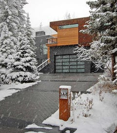 Snow falls at the Dayton Residence in Vail, Colorado.