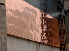 installation of raw copper panels at Freedom Center.