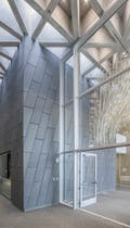 Interior space with custom zinc feature wall at KCPD Headquarters.