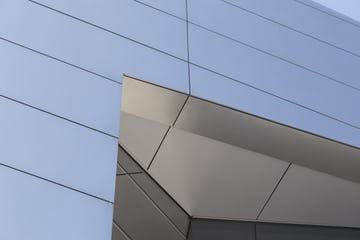 Detail of the thick machined plate stainless steel on the IBM Headquarters.
