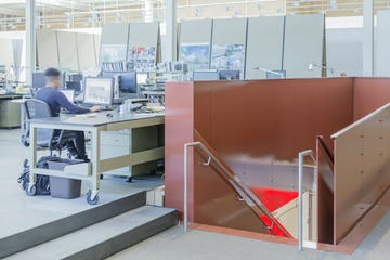 Second floor offices, showing the red-painted stairwell panels manufactured by Zahner.
