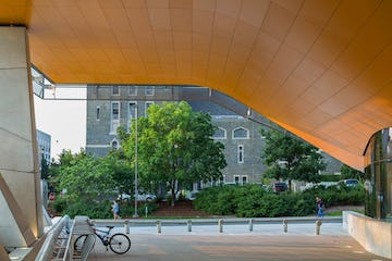 Photograph of orange-coated aluminum soffit panel system at Gates Hall.