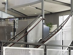 Detail of the handrail screens in square perf