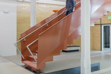 The design includes a clever handrail extension, meeting ADA requirements.