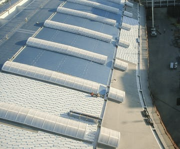 Zahner roofing team installs the stainless steel skins on the DFW Terminal D roof.