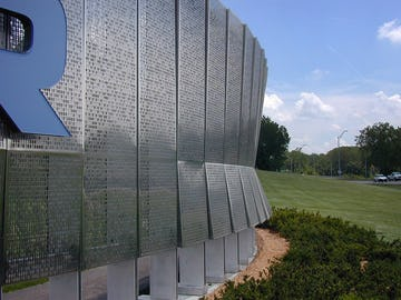 Detail of the perforated metal signage system at Cerner Headquarters.