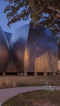 Ohr-O'Keefe Museum of Art at dusk, designed by Frank Gehry Partners.