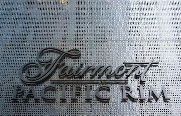 Detail of the Fairmont Pacific Rim perforated panels and signage.