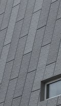 Detail of the punched and custom-embossed zinc exterior facade at KCPD Headquarters.