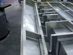 Fabricating the Fisher Center stainless steel and aluminum panels at A. Zahner Company in Kansas City.