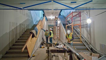 Installation of Kauffman Center interior metalwork by Zahner field operators.